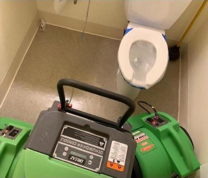 toilet room with green equipment